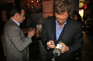 Josh Lucas signs Dobel bottle for charity