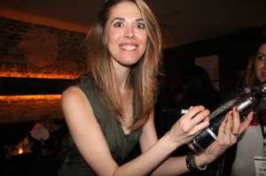 Lucy Owen Signs Dobel bottle for charity